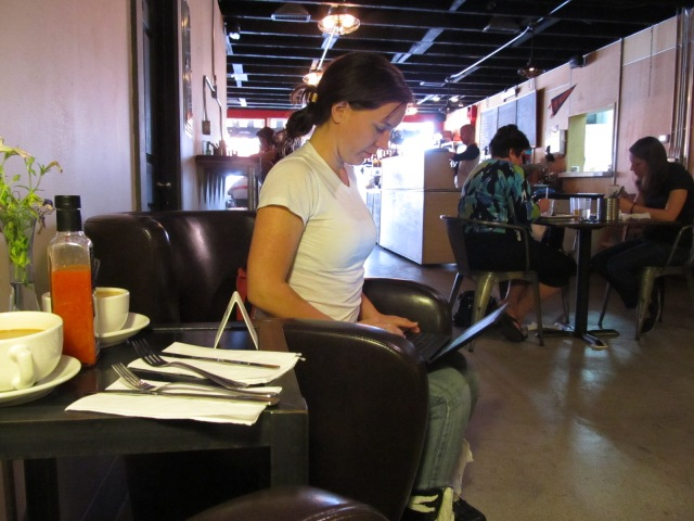The ubiquitous Justi in a cafe pic.